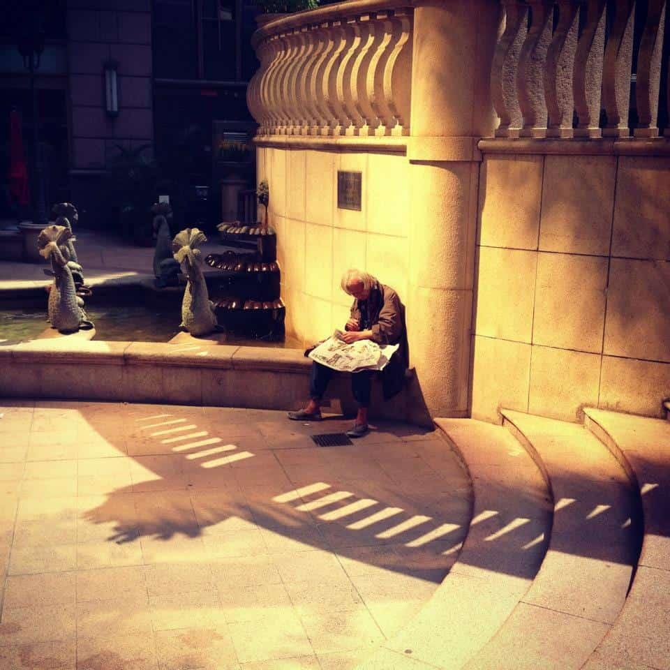 Old man reading a newspaper, Sheung Wan.