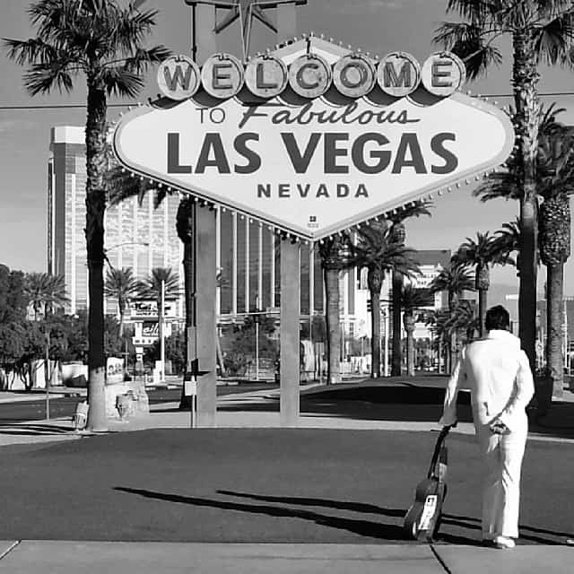 elvis in front of welcome to las vegas sign
