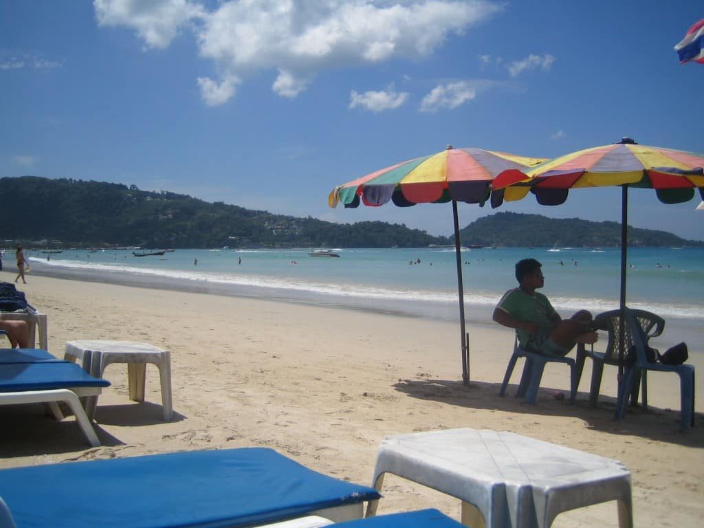 A vendor waits for parasailing customers. Photo by Anne Castagnaro, 2013